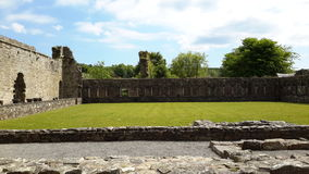 Jerpoint Abbey Thomastown Kilkenny Ireland. A view Inside Jerpoint Abbey Thomastown Kilkenny Ireland sunny day ruins of abbey stock images