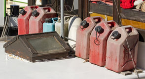Jerry cans of fuel. Reserve on a boat Stock Images