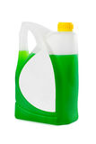 Jerrycan with green liquid and blank label Royalty Free Stock Image