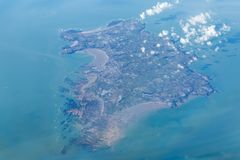 Jersey from the Air. A photograph of the whole  island of Jersey, taken from the flight deck of an airplane Stock Photo