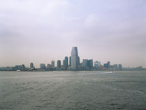 Jersey City on a cloudy day. View from the Staten Island Ferry Stock Photos