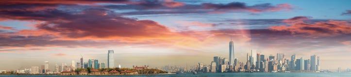 Jersey City, Ellis Island and Manhattan, view at dusk Stock Photos