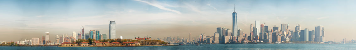 Jersey City, Ellis Island and Manhattan, view at dusk Royalty Free Stock Photo