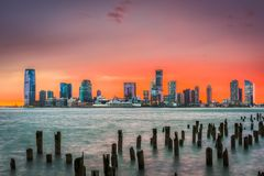 Jersey City, New Jersey, USA. Skyline across the Hudson River after sunset stock images