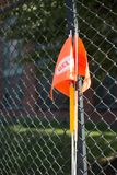 Orange traffic flag on the roadside stock images
