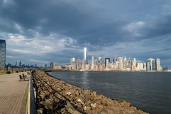 Jersey City, NJ / USA  - March 2016: the City of New York as seen from Liberty State Park at the spring cloudy day Royalty Free Stock Photo