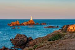 Jersey del faro ad alba e ad alta marea Fotografie Stock Libere da Diritti