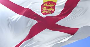 Jersey flag waving at wind with blue sky in slow, loop. Flag of Jersey waving at wind with blue sky in slow, looped stock video
