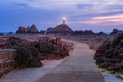 Jersey fyr på solnedgången fotografering för bildbyråer