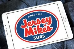 Jersey Mike`s Subs fast food chain logo. Logo of Jersey Mike`s Subs restaurant on samsung tablet. Jersey Mike`s Subs is an American submarine sandwich chain royalty free stock photos