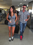 Jersey Shore girl Jwow with boyfriend at LAX. LOS ANGELES-AUGUST 29: Jersey Shore girl Jwow with boyfriend at LAX airport. August 29 in Los Angeles, California Royalty Free Stock Photography