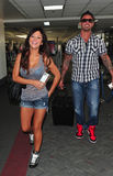 Jersey Shore girl Jwoww with boyfriend at LAX. LOS ANGELES-AUGUST 29: Jersey Shore girl Jwoww with boyfriend at LAX airport. August 29 in Los Angeles, California Stock Photography