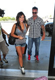 Jersey Shore girl Jwoww with boyfriend at LAX. LOS ANGELES-AUGUST 29: Jersey Shore girl Jwoww with boyfriend at LAX airport. August 29 in Los Angeles, California Stock Photos
