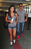 Jershey Shore star Jwow with boyfriend at LAX. LOS ANGELES-AUGUST 28: Jershey Shore star Jwow with boyfriend at LAX airport. August 28 in Los Angeles, California Stock Images