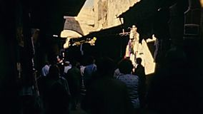 Jerusalem arcade alleys. JERUSALEM, ISRAEL - CIRCA 1981: tourists in typical old fashion dress, visiting the arcade alleys of the El Wad ha Gai street and street stock footage