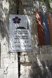 Jerusalem, Armenian Quarter, 15 August 2017, Commemorating the A. A freshly-placed banner in four languages, placed next to the Armenian flag, on a wall in the Royalty Free Stock Photography