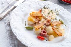 Jerusalem artichoke au gratin with ham and chili Stock Images