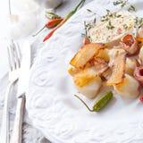 Jerusalem artichoke au gratin with ham and chili Royalty Free Stock Photos