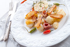 Jerusalem artichoke au gratin with ham and chili Stock Photos
