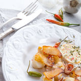 Jerusalem artichoke au gratin with ham and chili Royalty Free Stock Photography