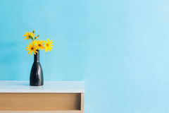 Jerusalem artichoke flower in vase on table interior design Stock Photography