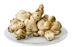 Jerusalem artichoke on the plate. Isolated Royalty Free Stock Image