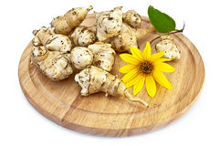 Jerusalem artichoke on a round board stock photos