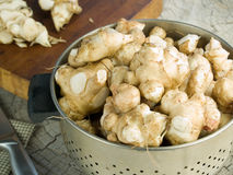 Jerusalem artichokes in a colander Royalty Free Stock Photography