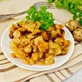 Jerusalem artichokes fried in dish on napkin Royalty Free Stock Photo