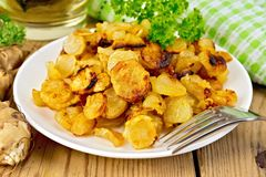 Jerusalem artichokes fried with parsley in bowl Stock Images