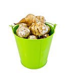 Jerusalem artichokes in a green bucket Royalty Free Stock Images