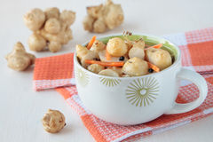 Jerusalem artichokes, marinated with carrots Stock Photos