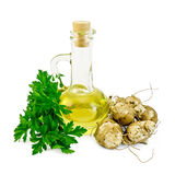 Jerusalem artichokes with oil and parsley Stock Photos