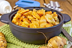 Jerusalem artichokes roasted in pan with meter Royalty Free Stock Images