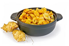 Jerusalem artichokes roasted in pan Stock Images