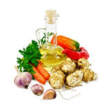 Jerusalem artichokes with vegetables and oil Royalty Free Stock Photo