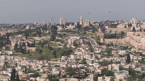 Jerusalem old city aerial perspective as birds fly high. Jerusalem buildings shot taken from a high vantage point birds fly in sky stock video