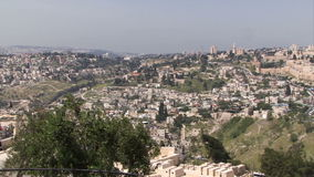 Jerusalem old city aerial perspective and trees in foreground stock footage