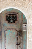 Jerusalem door. Copper or Brass metal door with patina, wrought iron minora and locks in the Old Cty of Jersualem, Israel Royalty Free Stock Photo