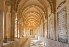 Jerusalem - The gothic corridor of atrium in Church of the Pater Noster on Mount of Olives. JERUSALEM, ISRAEL - MARCH 3, 2015: The gothic corridor of atrium in stock photos