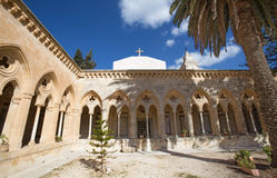 Jerusalem - The gothic corridor of atrium in Church of the Pater Noster on Mount of Olives. JERUSALEM, ISRAEL - MARCH 3, 2015: The gothic corridor of atrium in Royalty Free Stock Images