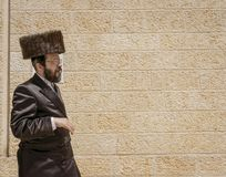 Free Jerusalem, Israel - 2019-04-26 - Orthodox Jew Walks In Front Of Wall Royalty Free Stock Photos - 161419318