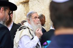 JERUSALEM, ISRAEL - APRIL 2017: Jewish hasidic pray a the Western Wall, Wailing Wall the Place of Weeping is an ancient limestone. Wall in the Old City of royalty free stock photo