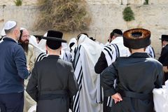 JERUSALEM, ISRAEL - APRIL 2017: Jewish hasidic pray a the Western Wall, Wailing Wall the Place of Weeping is an ancient limestone. Wall in the Old City of stock photo