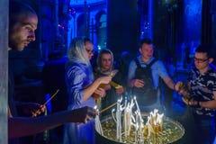 Orthodox good Friday 2018 in Jerusalem. Jerusalem, Israel - April 6, 2018: Orthodox good Friday scene in the church of the holy sepulcher, with pilgrims lighting Stock Photography