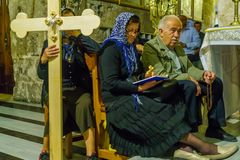 Orthodox good Friday 2018 in Jerusalem. Jerusalem, Israel - April 6, 2018: Orthodox good Friday scene in the church of the holy sepulcher, with pilgrims. The old Stock Photos