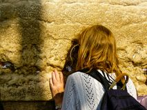 Colors of Israel. Jerusalem Israel April 16, 2018 Unknown woman praying front the Western Wall at the old city of Jerusalem on afternoon Stock Photo