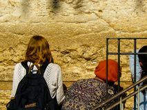 Colors of Israel. Jerusalem Israel April 16, 2018 Unknown woman praying front the Western Wall at the old city of Jerusalem on afternoon Stock Images