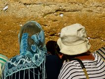 Colors of Israel. Jerusalem Israel April 16, 2018 Unknown woman praying front the Western Wall at the old city of Jerusalem on afternoon Royalty Free Stock Photography
