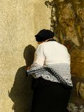 Colors of Israel. Jerusalem Israel April 16, 2018 Unknown woman praying front the Western Wall at the old city of Jerusalem on afternoon Stock Photos